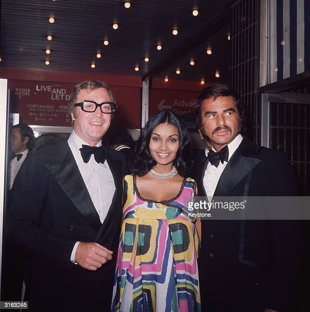 From l to r film star Michael Caine his wife Shakira Caine and film star Burt Reynolds at the premiere of the James Bond film 'Live and Let Die