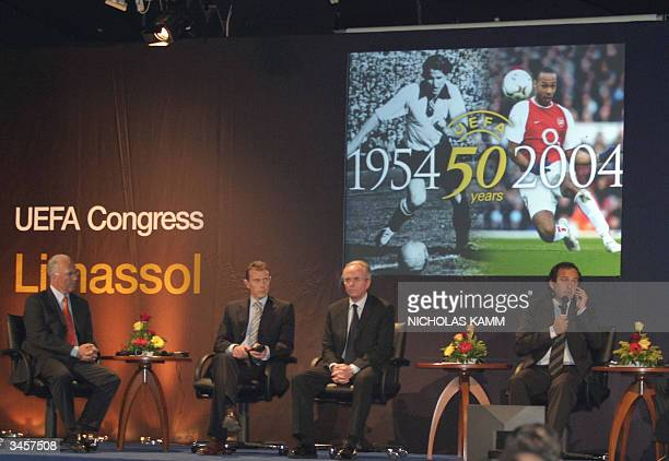 From L to R: Former German football star and current president of the 2006 World Cup organizing committee Franz Beckenbauer, former Spanish football...