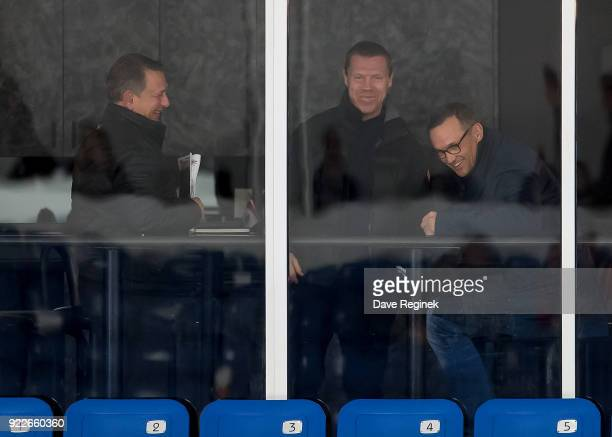 From L to R General Manager's Ken Holland Kris Draper and Steve Yzerman General Manager from the Tampa Bay Lightning share a laugh while they watch...