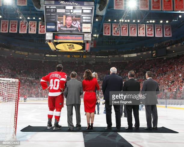 From L to R Henrik Zetterberg of the Detroit Red Wings former Detroit Red Wing Ted Lindsay wife Emma Andersson Zetterberg holding her son Love father...