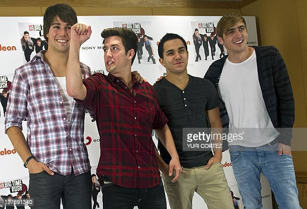 James Maslow Logan Herderson Kendall Schmidt Carlos Pena members of the US Big Time Rush group pose with their 'Golden Disc' during a photo...