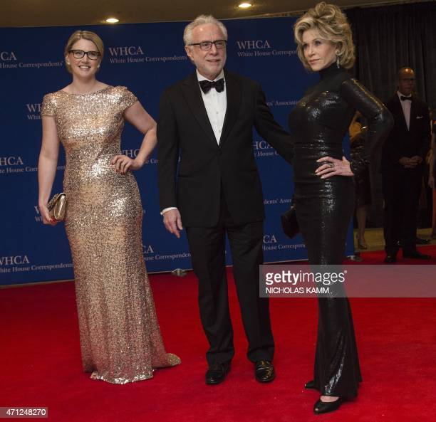 From L to R Marie Harf Wolf Blitzer and Jane Fonda arrive at the White House Correspondents' Association annual dinner in Washington DC on April 25...