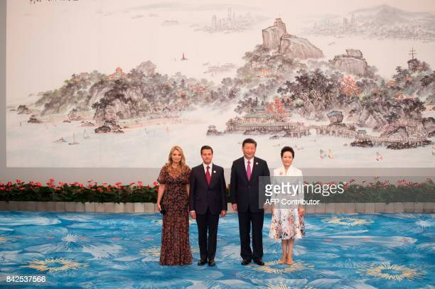 Mexican President Enrique Pena Nieto Mexican First Lady Angelica Rivera Chinese President Xi Jinping and his wife Peng Liyuan pose during a photo...