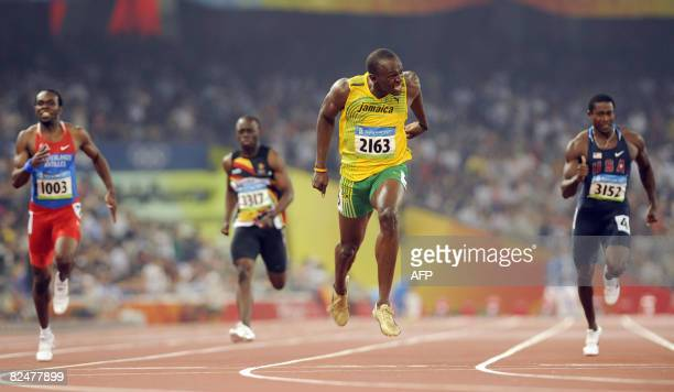 Netherlands Antilles' Churandy Martina Zimbabwe Brian Dzingai Jamaican Usain Bolt and US Shawn Crawford compete in the final of the men's 200m at the...