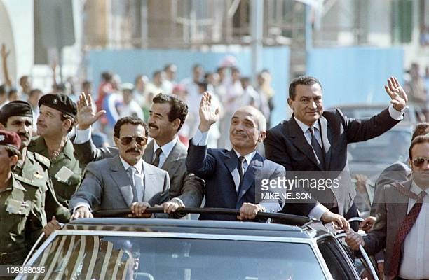 North Yemeni President Ali Abdullah Saleh Iraqi President Saddam Hussein Jordanian King Hussein and Egyptian President Hosni Mubarak wave to the...