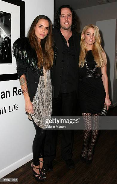 From L to R Photographer Tasya Van Ree Aaron Cohen and actress Amber Heard attend The Tasya Van Ree Art Exhibit hosted by Amber Heard on February 11...
