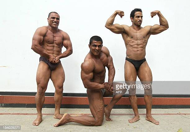 Shodhan Rai Shakar Gowda and Captain Roshan bodybuilders from the Indian Fitness And Body Builders Federation from Karnataka flex their muscles...