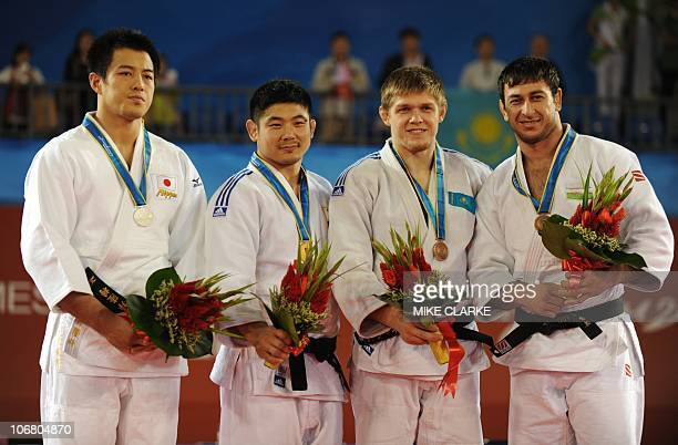 Takamasa Anai of Japan with his silver medal Hwang HeeTae of South Korea with his gold Maxim Rakov of Kazakhstan with his bronze and Ramziddin...