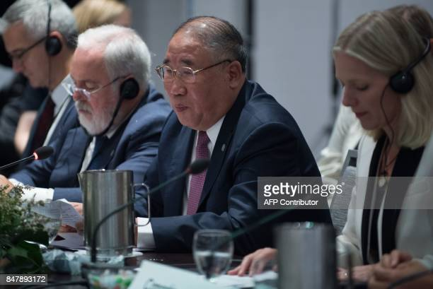 the European Union's top climate official Miguel Arias Canete China's representative on climate change Xie Zhenhua and Canadian Environment Minister...