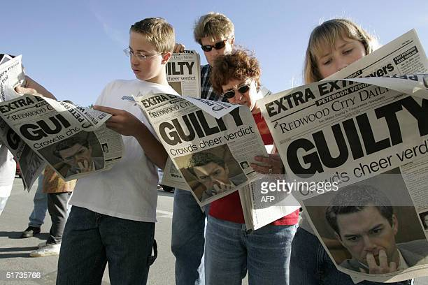 From L to R twelveyearold Danny Lewin Geoff Shenk Katherine Lewin and 12yearold Katie Lewin read an extra edition put out by the Redwood City Daily...