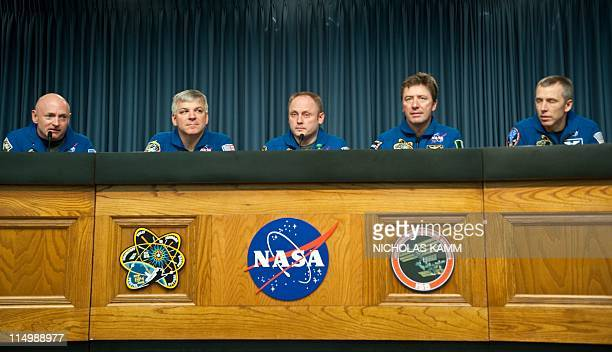 From L to R US space shuttle Endeavour Cpommandere Mark Kelly Pilot Gregory Johnson and Mission Specialists Michael Fincke Roberto Vittori of Italy...