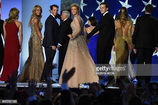 Vanessa and Donald Trump Jr Ivanka Trump and Jared Kushner salute the crowd after dancing on stage during the Freedom ball at the Walter E Washington...
