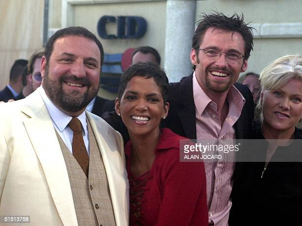 From L US producer Joel Silver pose with US actress Halle Berry Australian actor Hugh Jackman and his wife 01 September 2001 in Deauville before the...