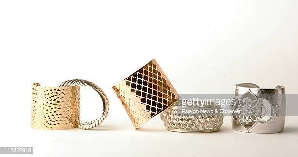 From left 14karat gold cuff in an animal print pattern from the estate and antique collection David Yurman sterling silver crisscross cuff Rebecca...