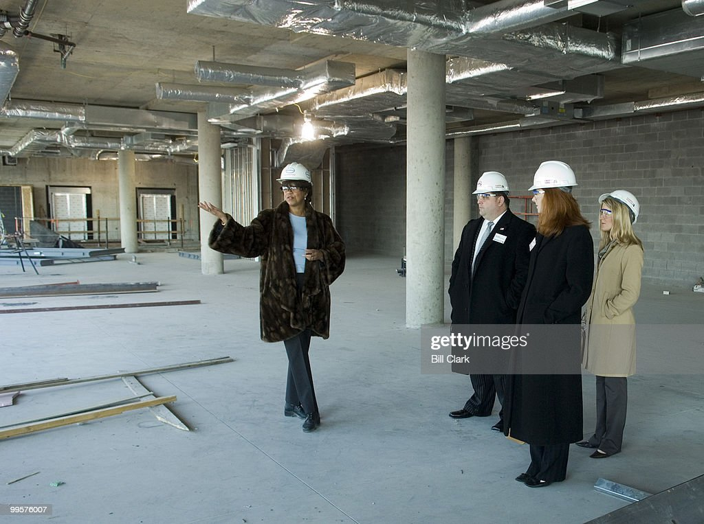 From left, a Newseum representative shows off the 7th floor of the new Newseum building to Ryan James, communications director for Rep. Boozman of Arkansas, Katie Laning, press secretary for Sen. Lincoln of Arkansas, and Courtney Rowe, press assistant for Sen. Lincoln of Arkansas, on Tuesday, Feb. 27, 2007. The Canadian Embassy, located next door, invited Congressional press secretaries for breakfast and a tour of the Newseum, which is slated to open in the fall of this year.