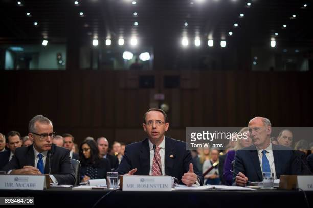 From left acting FBI Director Andrew McCabe Deputy Attorney General Rod Rosenstein and Director of National Intelligence Dan Coats appear before a...