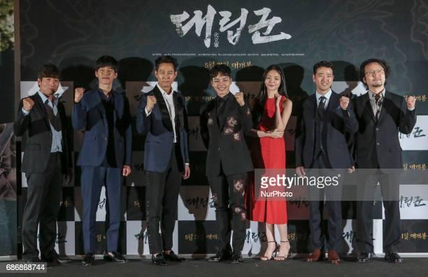 From left Actor Park Won Sang Kim Mu Yeol Lee Jung Jae Yeo Jin Goo Actress Esom Actor Bae Soo Hyun Director Jeong Yoon Cheol stand pose for photo...