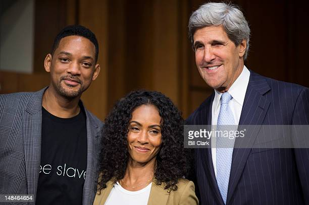 From left, actor Will Smith, his wife Jada Pinkett Smith and chairman John Kerry, D-Mass., arrive for the Senate Foreign Relations Committee hearing...
