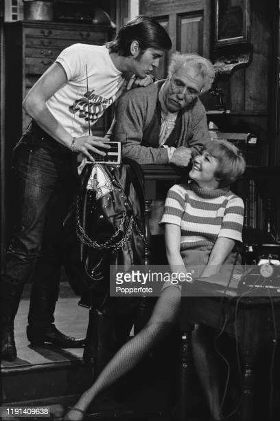 From left actors Nicky Henson Bill Fraser and an unidentified female actress appear in a scene from the ABC Weekend Television comedy series 'Vacant...