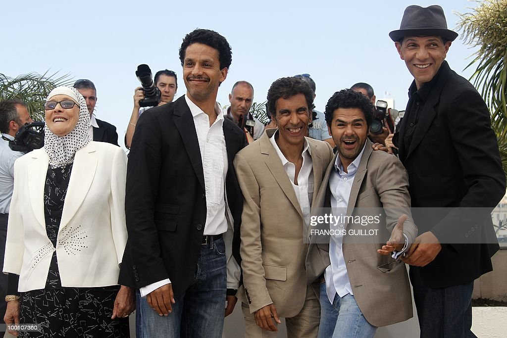 actress Chafia Boudraa, French actor Sami Bouajila, French director Rachid Bouchareb, French actor Jamel Debbouze and French actor Roschdy Zem pose during the photocall of 'Hors La Loi' (Outside of the Law) presented in competition at the 63rd Cannes Film Festival on May 21, 2010 in Cannes.