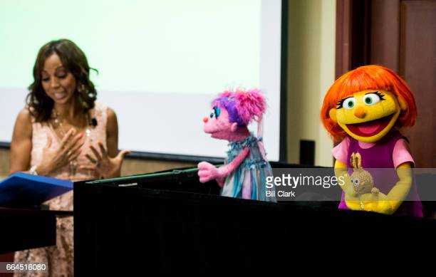From left actress Holly Robinson Peete and Sesame Street character Abby Cadabby introduce the newest Sesame Street Muppet Julia a Muppet with autism...