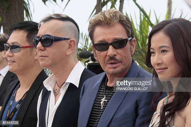 Actress Michelle Ye of HongKong French singer and actor Johnny Hallyday Anthony Wong and SiuFai Cheung of Hong Kong pose during the photocall of...