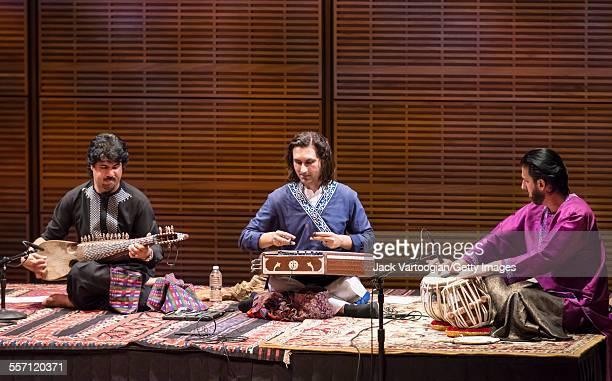 From left Afghan emigre musician Homayun Sakhi on the Afghan rubab Indian musician Rahul Sharma on the hammered dulicmerlike santur and Afghan emigre...