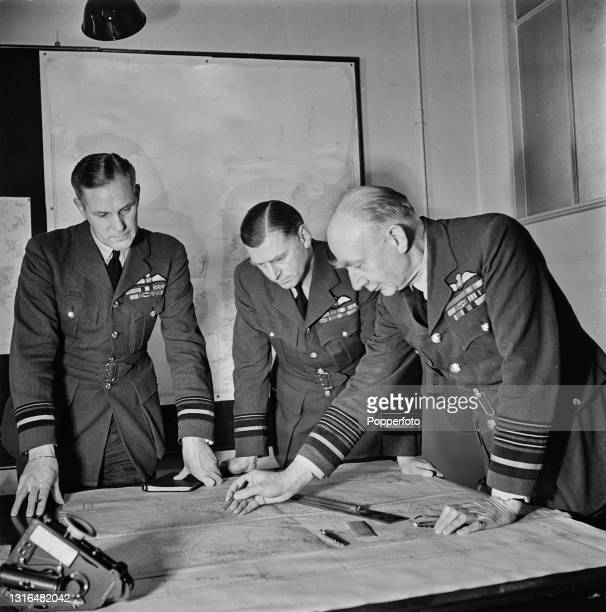 From left, Air Vice Marshal Frederick Hards , Air Vice Marshal Geoffrey Rhodes Bromet and Air Chief Marshal Frederick Bowhill study a map at a Royal...