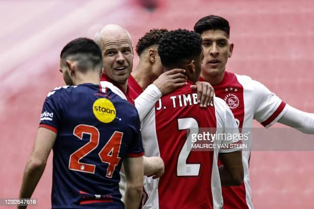 Ajax's Dutch midfielder Davy Klaassen, Mexican defender Edson Alvarez and Dutch defender Jurrien Timber celebrate their 1-0 goal during the Dutch...