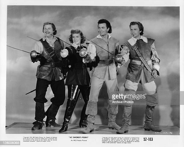 From left, Alan Hale Jr, Maureen O'Hara, Cornel Wilde, and Dan O'Herlihy in a scene from the film 'At Sword's Point', aka 'Sons of the Musketeers',...