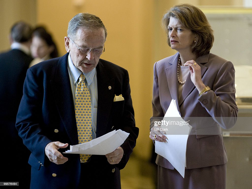 From left, Alaska Senators Ted Stevens and Lisa Murkowski talk as they leave the weekly Senate Republican Policy luncheon in the Capitol on Tuesday, April 15, 2008.
