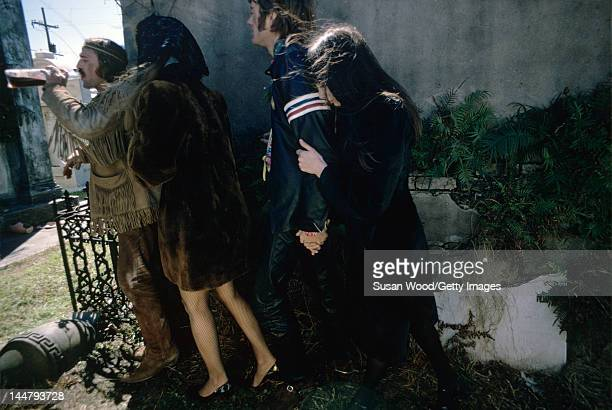 From left American actor and director Dennis Hopper and actors Karen Black Peter Fonda and Toni Basil at the St Louis Cemetery during the filming of...