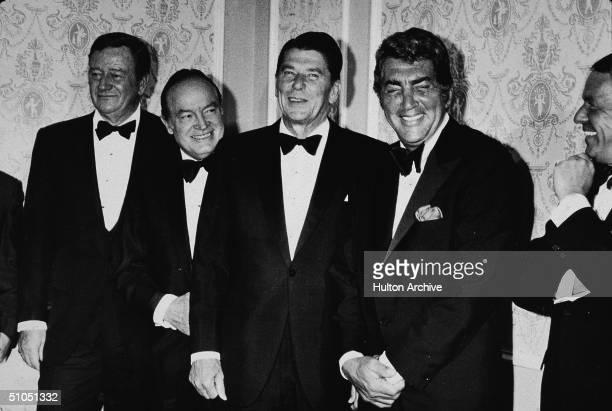 From left, American actor John Wayne , British-born American entertainer Bob Hope , California governor Ronald Reagan , American actor Dean Martin ,...