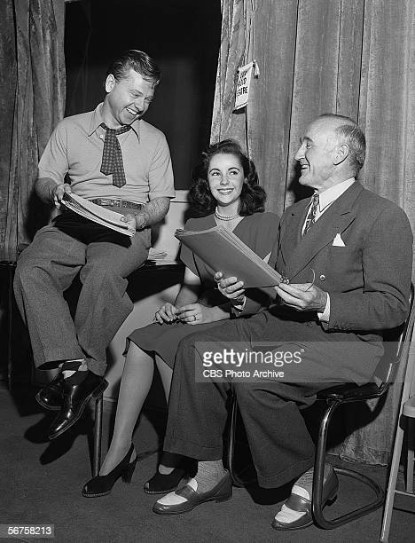 From left, American actor Mickey Rooney rehearses with British-born actors Elizabeth Taylor and Donald Crisp in preparation for a broadcast of the...