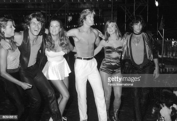 From left American actors April Allen Patrick Swayze Katherine Kelly Lang Greg Bradford Maureen McCormick and Len Bari stand arm in arm during the...