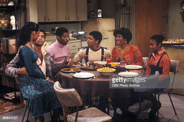 From left American actors BernNadette Stanis Ben Powers Jimmie Walker Ralph Carter Ja'net DuBois and Janet Jackson as they sit down for a meal in a...