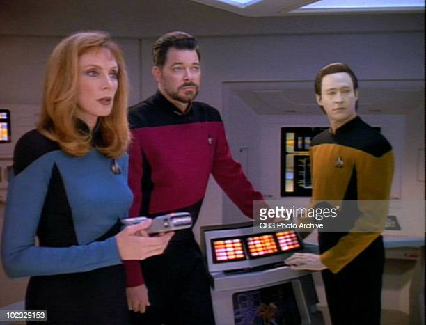 From left American actors Gates McFadden Jonathan Frakes and Brent Spiner in a scene from an episode of the television series 'Star Trek The Next...