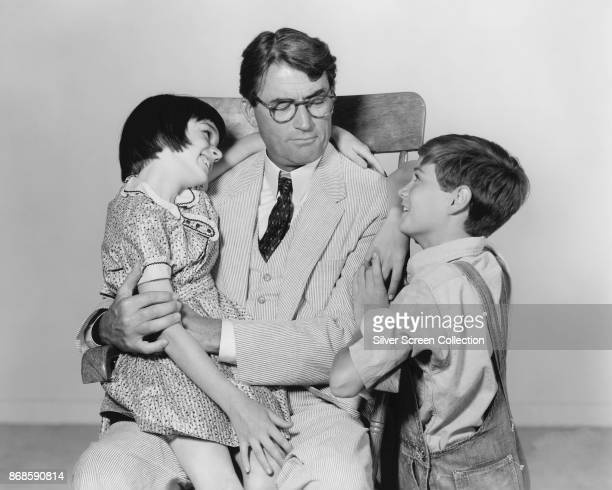 From left American actors Mary Badham Gregory Peck and Phillip Alford in a scene from 'To Kill a Mockingbird' 1962
