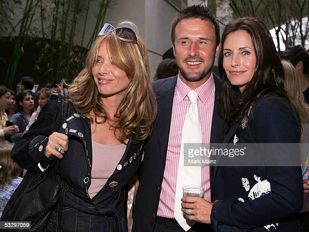 From left American actors Rosanna Arquette her brother David Arquette and his wife Courteney Cox Arquette pose for photographers at the EB Medical...