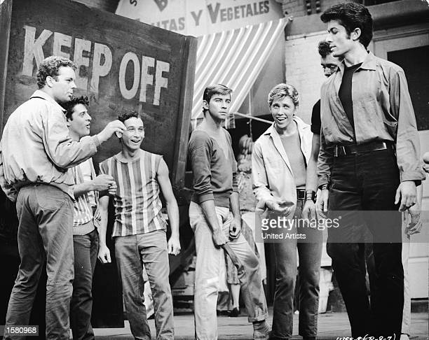 From left American actors Russ Tamblyn Tony Mordente Bert Michaels Tucker Smith and Anthony 'Scooter' Teague taunt George Chakiris in a still from...