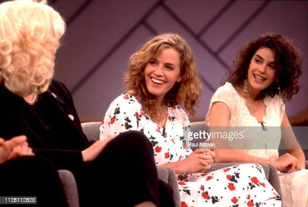 From left American actresses Cathy Moriarty Elizabeth Shue and Teri Hatcher share a laugh as they promote their film 'Soapdish' on the Oprah Winfrey...