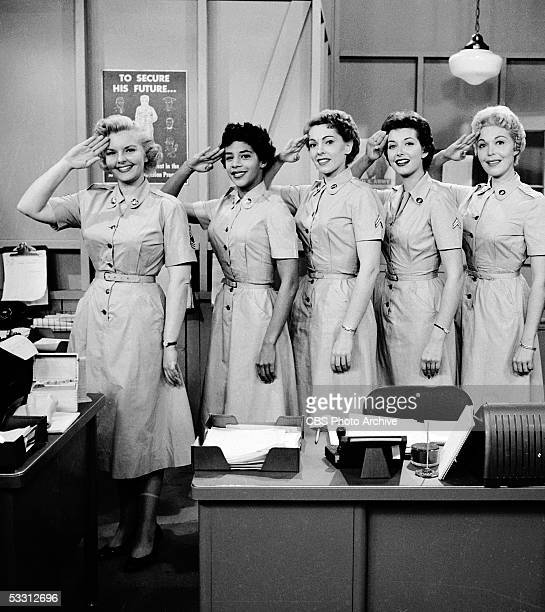American actresses Elisabeth Fraser Billie Allen Barbara Berry Midge Ware Fay Morley salute at the camera on the set of the comedy series 'The Phil...
