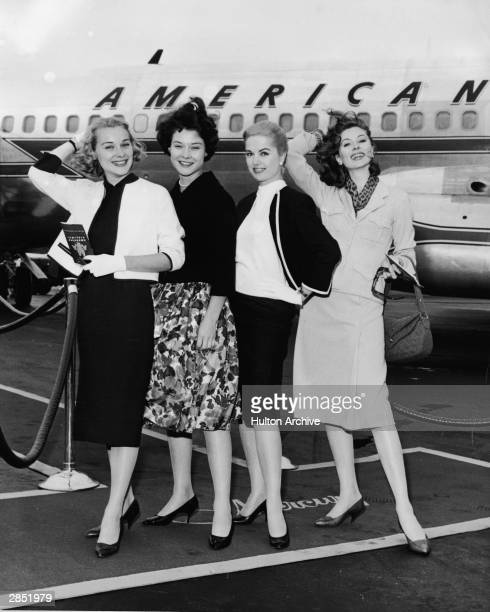 From left American actresses Hope Lange Diane Baker Martha Hyer and Suzy Parker pose for a photo at Idlewild Airport as they get ready to board an...