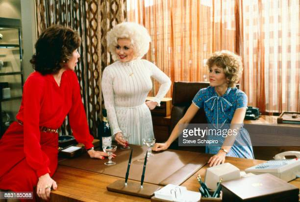 From left, American actresses Lily Tomlin , Dolly Parton , and Jane Fonda , in a scene from the film '9 to 5' , Los Angeles, California, 1979.