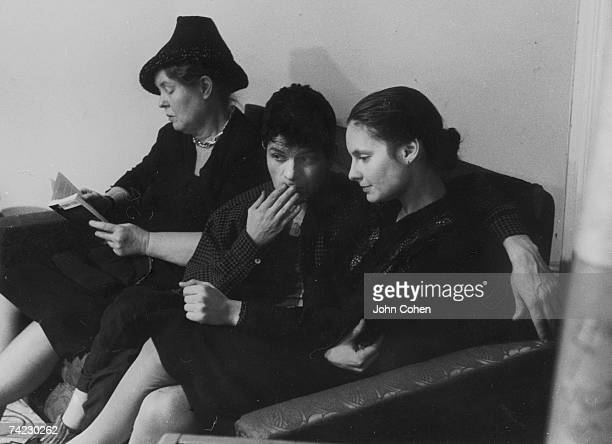 From left American artist Alice Neel American poet Gregory Corso and American dancer and choreographer Sally Gross sit together on a couch on the set...