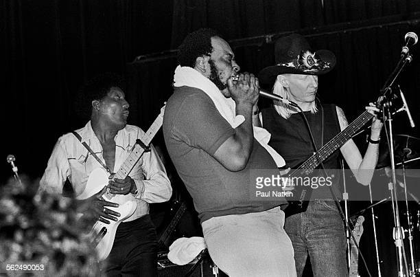 From left American Blues musicians Albert Collins James Cotton and Johnny Winter perform on stage at the Park West Auditorium Chicago Illinois...