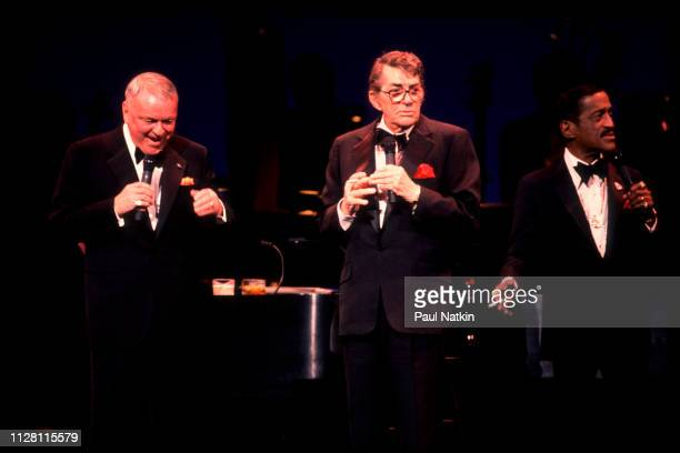 From left American entertainers Frank Sinatra Dean Martin and Samuel Davis Jr perform onstage at the Chicago Theater Chicago Illinois March 1 1989