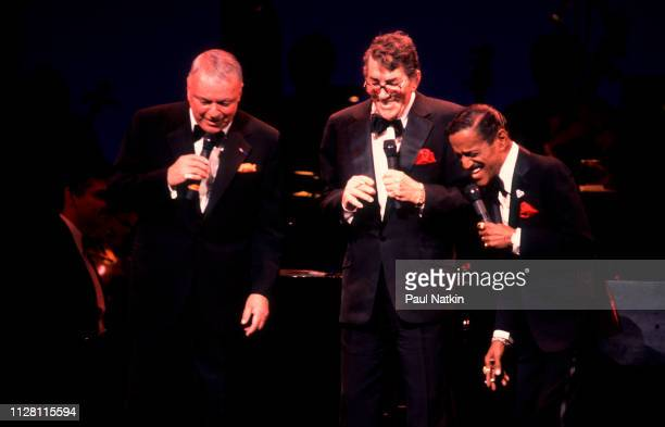 From left, American entertainers Frank Sinatra , Dean Martin , and Samuel Davis Jr perform onstage at the Chicago Theater, Chicago, Illinois, March...