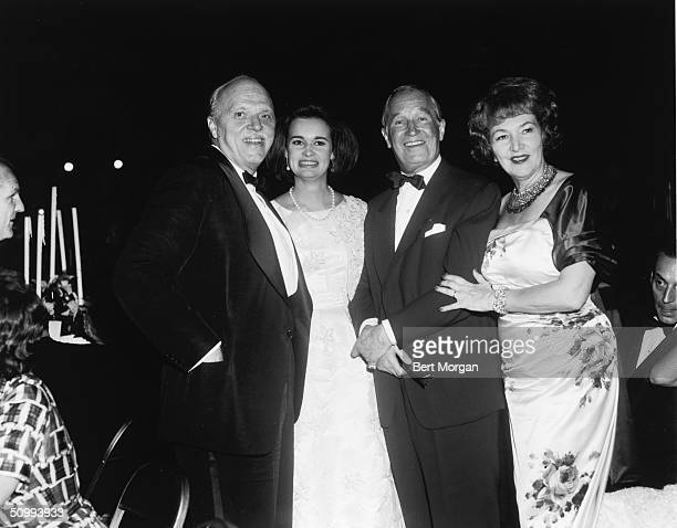 From left, American film director Joshua Logan , American heiress and socialite Gloria Vanderbilt, French singer and actor Maurice Chevalier , and...