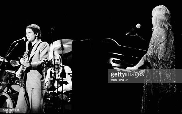 From left American musician Lindsey Buckingham and British musicians Mick Fleetwood and Christine McVie of the group Fleetwood Mac perform onstage at...